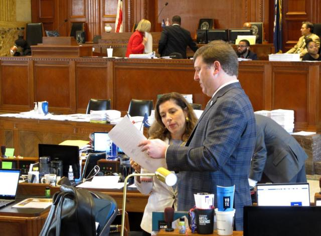 Reps. Aimee Freeman, D-New Orleans, and Jean-Paul Coussan, R-Lafayette, review bill language on the House floor on Wednesday, June 9, 2021, in Baton Rouge, La. (AP Photo/Melinda Deslatte)