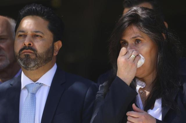 Santa Clara Valley Transportation Authority member Magdalena Carrasco, right, wipes away tears during a news conference honoring nine colleagues killed by a coworker on Thursday, May 27, 2021, in San Jose, Calif. A gunman who killed nine people at a California rail yard appeared to target some of the victims as he fired 39 shots, a sheriff told The Associated Press on Thursday, a day after his ex-wife said he would stew about perceived slights at work and threatened to kill co-workers a decade ago. (Aric Crabb/Bay Area News Group via AP)