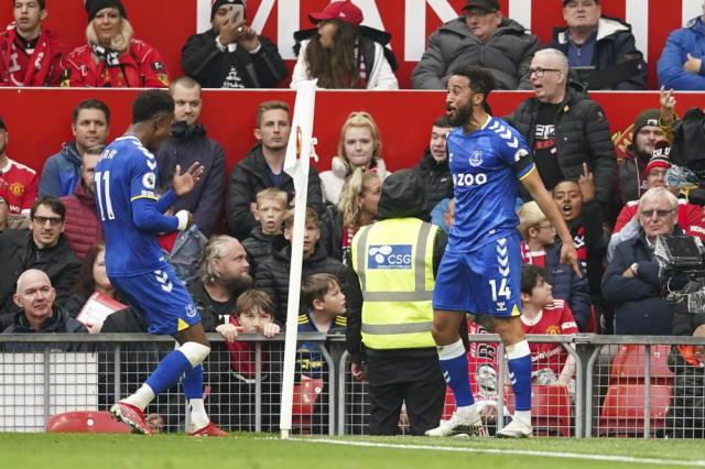 Everton's Andros Townsend, right, celebrates after scoring his side's opening goal during the English Premier League soccer match between Manchester United and Everton, at Old Trafford, Manchester, England, Saturday, Oct. 2, 2021. (AP Photo/Dave Thompson)