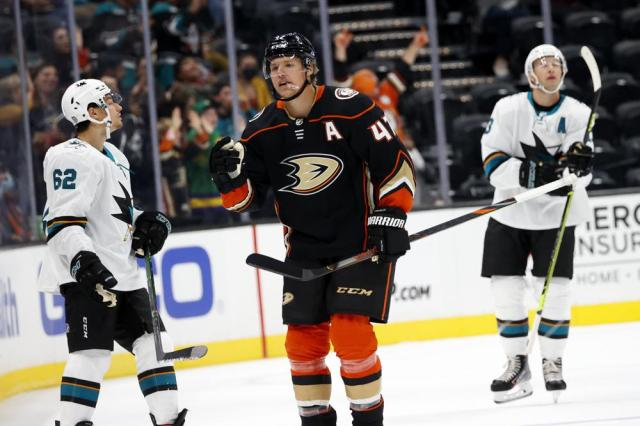 Anaheim Ducks defenseman Hampus Lindholm, center, celebrates his goal against the San Jose Sharks during the first period of an NHL hockey game Sunday, Sept. 26, 2021, in Anaheim, Calif. (AP Photo/Ringo H.W. Chiu)
