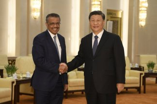 Behind the scenes, tension between China and WHO