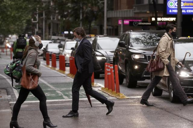 People and cars filter into the city after more than 100 days of lockdown to help contain the COVID-19 outbreak in Sydney, Monday, Oct. 11, 2021. (AP Photo/Rick Rycroft)