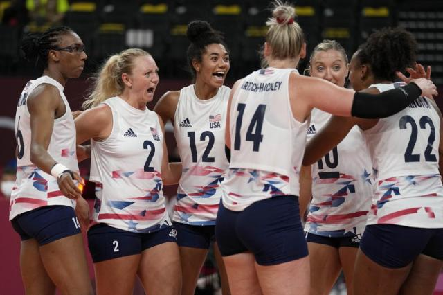 United States teammates celebrate winning a point during the women's volleyball preliminary round pool B match between China and United States at the 2020 Summer Olympics, Tuesday, July 27, 2021, in Tokyo, Japan. (AP Photo/Frank Augstein)