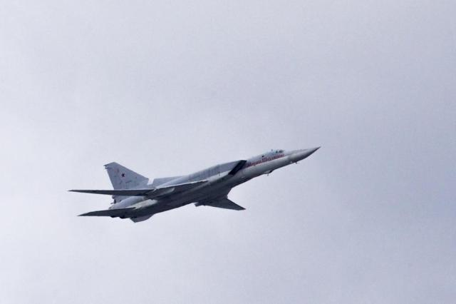 FILE - In this Thursday, May 5, 2016 file photo, a Russian Tu-22M3 bomber flies over Moscow's Kremlin during a general rehearsal for the Victory Day military parade which will take place at Moscow's Red Square on May 9 to celebrate 71 years after the victory in WWII in Moscow, Russia. The Russian military said Tuesday May 25, 2021, it has deployed three nuclear-capable long-range Tu-22M3 bombers to its base in Syria, a move that would strengthen Moscow's military foothold in the Mediterranean. (AP Photo/Ivan Sekretarev, File)