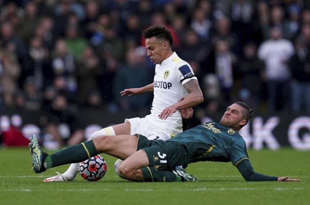 Leeds United's Rodrigo, left, and Watford's Francisco Sierralta battle for the ball during the English Premier League soccer match between Leeds United and Watford at Elland Road, Leeds, England, Saturday Oct. 2, 2021. (Mike Egerton/PA via AP)
