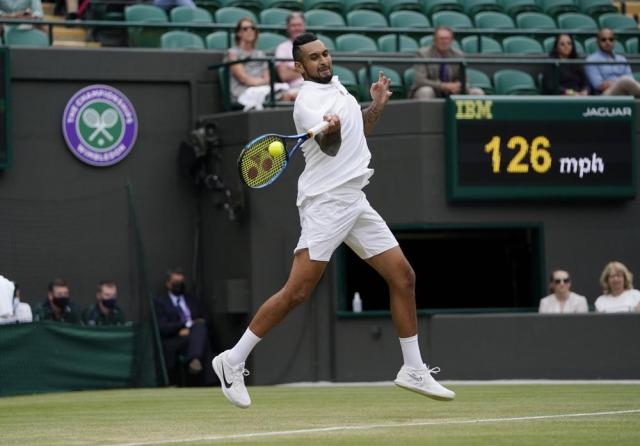 Australia's Nick Kyrgios plays a return to Canada's Felix Auger-Aliassime during the men's singles third round match on day six of the Wimbledon Tennis Championships in London, Saturday July 3, 2021. (AP Photo/Alberto Pezzali)