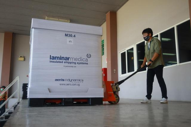 In this photo released by Siam Bioscience, a worker loads AstraZeneca COVID-19 vaccines produced by Siam Bioscience from its factory in Nonthaburi province, Thailand, Wednesday, June 2, 2021. AstraZeneca's partner in Thailand on Wednesday began its first deliveries of COVID-19 vaccines after concerns they were behind on their production schedules for the country and parts of Southeast Asia. (Siam Bioscience via AP)