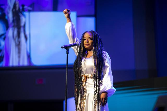 Leela James raises her fist after performing during a commemorative concert hosted by the George Floyd Foundation at The Fountain of Praise church on Sunday, May 30, 2021, in Houston. (Annie Mulligan/Houston Chronicle via AP)