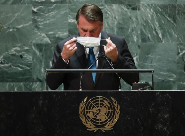 Brazil's President Jair Bolsonaro puts back on a protective face mask after speaking during the 76th Session of the U.N. General Assembly in New York on Tuesday, Sept. 21, 2021.   (Eduardo Munoz/Pool Photo via AP)