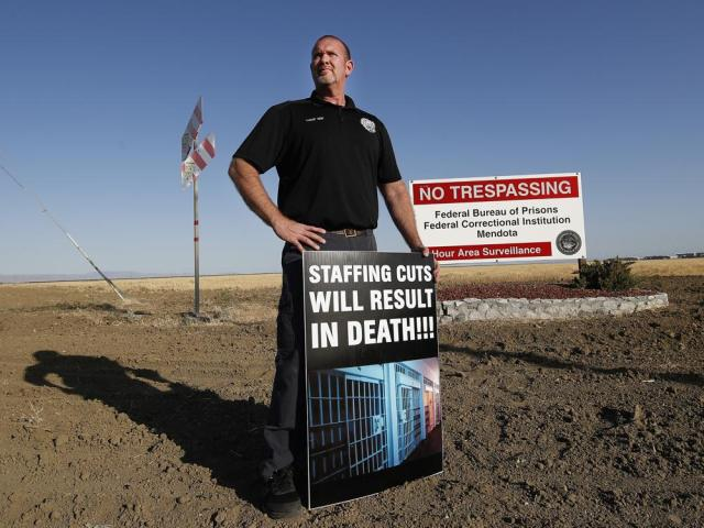 Aaron McGlothin, union president at the Federal Correctional Institution at Mendota, poses for a photo while leading a protest against staffing shortages, near the prison entrance in Mendota, Calif., Monday, May 17, 2021. (AP Photo/Gary Kazanjian)