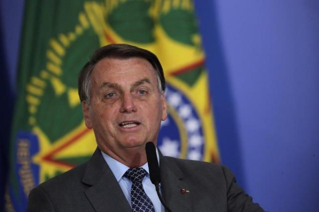 Brazil's President Jair Bolsonaro attends the launching ceremony of the Asphalt Giants Program, at the Planalto presidential palace, in Brasilia, Brazil, Tuesday, May 18, 2021. According to the Ministry of Infrastructure, the program offers facilities such as offering special lines of credit to purchase trucks or maintenance, predictability in the price of diesel oil, and faster vaccination of truck drivers against COVID-19. (AP Photo/Eraldo Peres)