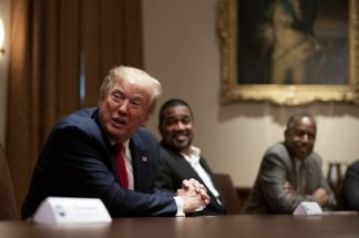 At a meeting with a handful of African-American supporters, President Trump says he will hold his first rally on June 19 in Tulsa, Oklahoma