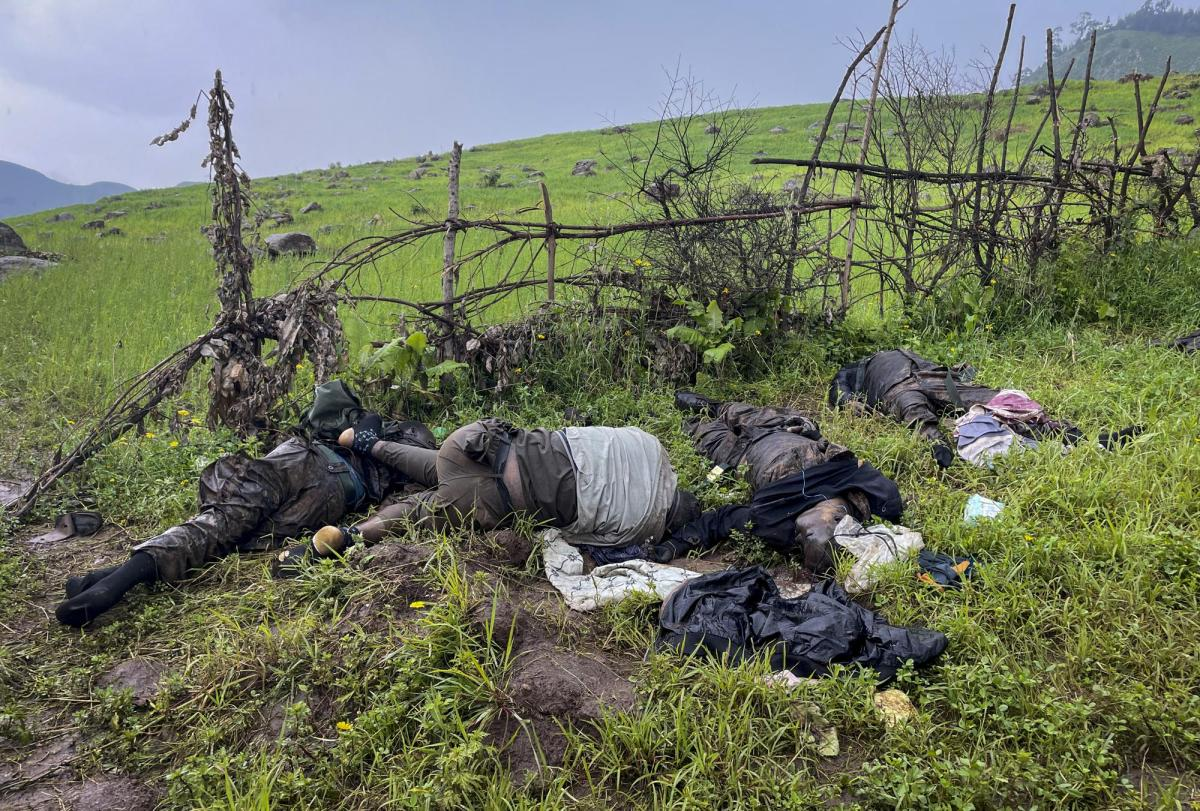 """The dead bodies of unidentified people wearing military uniforms lie on the ground near the village of Chenna Teklehaymanot, in the Amhara region of northern Ethiopia Thursday, Sept. 9, 2021. At the scene of one of the deadliest battles of Ethiopia's 10-month Tigray conflict, witness accounts reflected the blurring line between combatant and civilian after the federal government urged all capable citizens to stop Tigray forces """"once and for all."""" (AP Photo)"""
