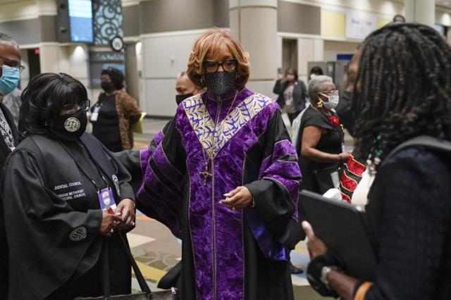 Bishop Vashti M. McKenzie greets officers during the opening worship service at the African Methodist Episcopal Church conference Tuesday, July 6, 2021, in Orlando, Fla. (AP Photo/John Raoux)