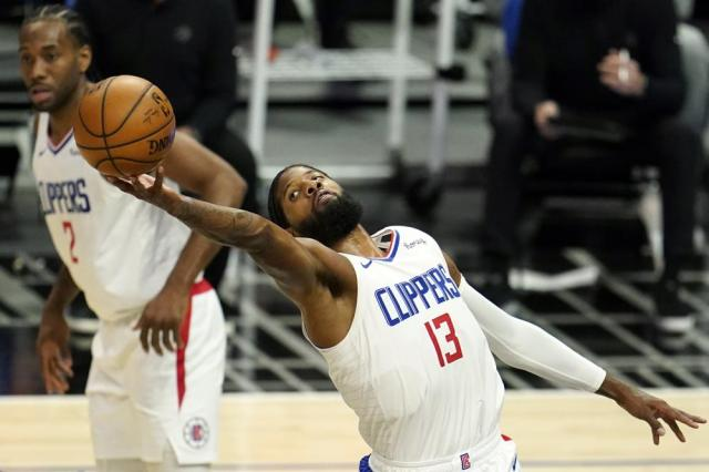 FILE - In this May 4, 2021, file photo, Los Angeles Clippers guard Paul George grabs a rebound during an NBA basketball game against the Toronto Raptors in Los Angeles. (AP Photo/Marcio Jose Sanchez, File)