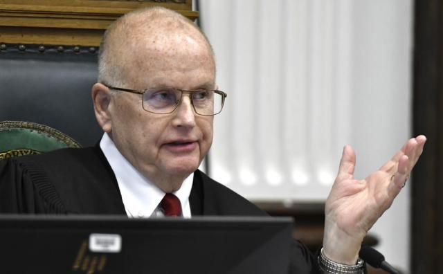 Judge Bruce Schroeder presides over a motion hearing, Tuesday, Oct. 5, 2021, in Kenosha, Wis., for Kyle Rittenhouse, who is accused of shooting three people during a protest against police brutality in Wisconsin last year.  (Sean Krajacic/The Kenosha News via AP, Pool)