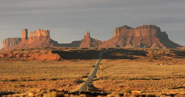 FILE - In this Oct. 25, 2018 file photo, Monument Valley is shown in Utah. The Navajo Nation has by far the largest land mass of any Native American tribe in the country. Now, it's boasting the largest enrolled population, too. The number grew to nearly 400,000 because of payments made to individual Navajos for hardships during the pandemic. The tribe now tops the Cherokee Nation's enrollment of 392,000, but a tribal spokeswoman says the Oklahoma tribe also is growing. (AP Photo/Rick Bowmer, File)