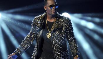"""R. Kelly performs at the BET Awards at the Nokia Theatre on Sunday, June 30, 2013, in Los Angeles. The R&B superstar known for his anthem """"I Believe I Can Fly,"""" was convicted Monday in a sex trafficking trial after decades of avoiding criminal responsibility for numerous allegations of misconduct with young women and children. (Photo by Frank Micelotta/Invision/AP)"""