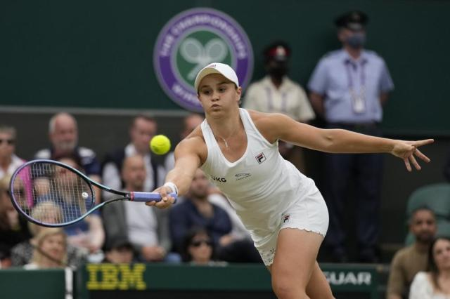Australia's Ashleigh Barty plays a return to compatriot Ajla Tomljanovic during the women's singles quarterfinals match on day eight of the Wimbledon Tennis Championships in London, Tuesday, July 6, 2021. (AP Photo/Kirsty Wigglesworth)