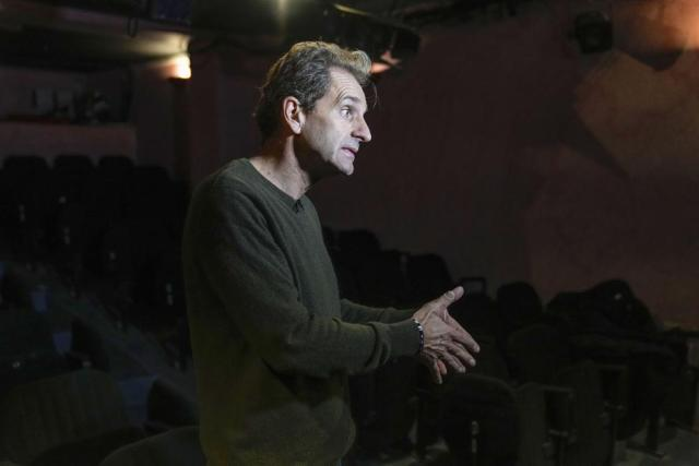 Author and actor Laurent Martinez gestures as he speaks during an interview with The Associated-Press at