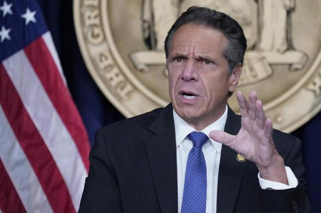 FILE — In this June 23, 2021 file photo, New York Gov. Andrew Cuomo speaks during a news conference, in New York. The federal government's count of the coronavirus dead in New York has 11,000 more victims than the tally publicized by the administration of Gov. Cuomo, which has stuck with a far more conservative approach to counting COVID-19 deaths. (AP Photo/Mary Altaffer)