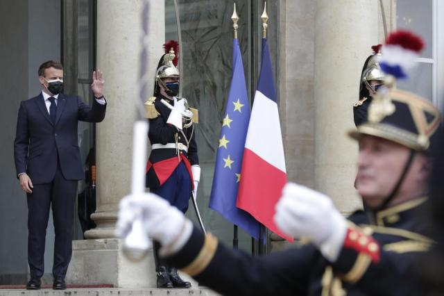 French President Emmanuel Macron waves good-bye to Egyptian President Abdel Fattah el-Sissi after their talks at the Elysee Palace, Monday, May 17, 2021 in Paris. U.N. Security Council diplomats and Muslim foreign ministers convened emergency weekend meetings to demand a stop to civilian bloodshed as Israeli warplanes carried out the deadliest single attacks in nearly a week of Hamas rocket barrages and Israeli airstrikes. (AP Photo/Thibault Camus, Pool)