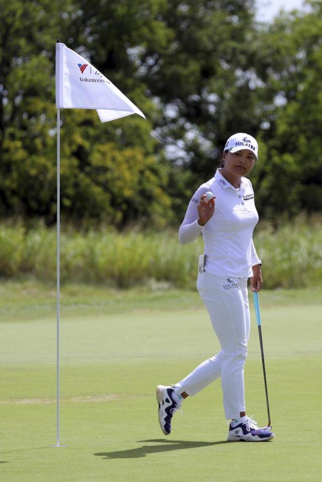 Jin Young Ko waves to the gallery after sinking her putt on the first green during the third round of the LPGA Volunteers of America Classic golf tournament in The Colony, Texas, Saturday, July 3, 2021. (AP Photo/Richard W. Rodriguez)