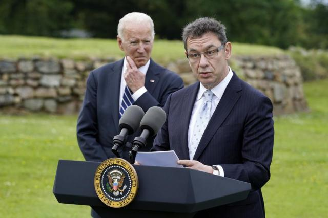 President Joe Biden listens as Pfizer CEO Albert Bourla speaks Thursday, June 10, 2021, in St. Ives, England. Biden spoke about his administration's global COVID-19 vaccination efforts ahead of the G-7 summit. (AP Photo/Patrick Semansky)