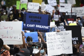 """""""I can't breathe"""" a rally cry being repeated for injustice done by police against two African Americans that led to their death"""