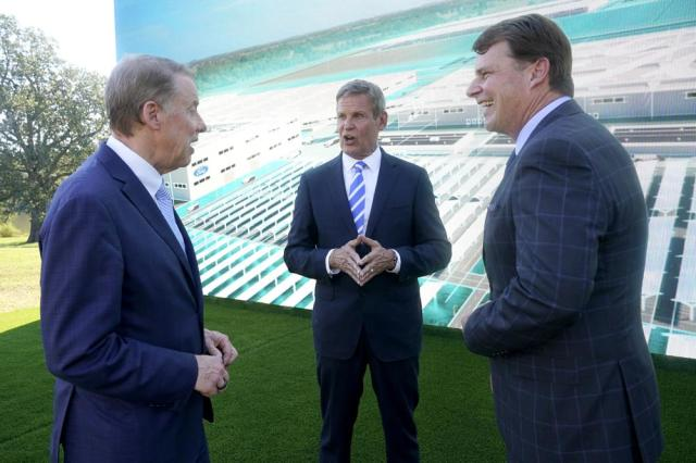 Ford Executive Chairman Bill Ford, left, and Jim Farley, Ford president and CEO, right, talk with Tennessee Gov. Bill Lee, center, after a presentation on the planned factory to build electric F-Series trucks and the batteries to power future electric Ford and Lincoln vehicles Tuesday, Sept. 28, 2021, in Memphis, Tenn. The plant in Tennessee is to be built near Stanton, Tenn. (AP Photo/Mark Humphrey)
