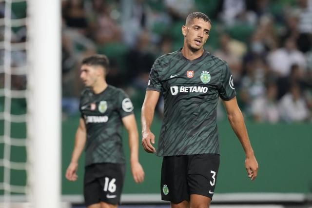 Sporting's Zouhair Feddal, right, reacts after Ajax's Steven Berghuis scored his side's third goal during a Champions League, Group C soccer match between Sporting CP and Ajax at the Alvalade stadium in Lisbon, Wednesday, Sept. 15, 2021. (AP Photo/Armando Franca)