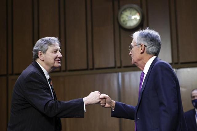 Sen. John Kennedy, R-La., greets Federal Reserve Chairman Jerome Powell before a Senate Banking, Housing and Urban Affairs Committee hearing on the CARES Act on Capitol Hill, Tuesday, Sept. 28, 2021 in Washington. (Kevin Dietsch/Pool via AP)