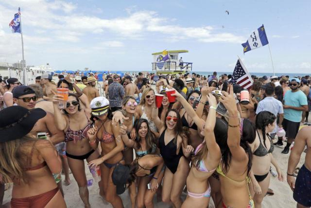 FILE - In this Monday, March 14, 2016, file photo, college students have fun during their spring break in South Beach, at Miami Beach, Fla. The mayor of Miami Beach is proposing changes to the South Beach party neighborhood, including limiting loud music and halting alcohol sales at 2 a.m. (AP Photo/Alan Diaz, File)
