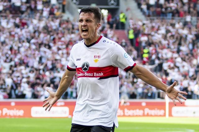 Stuttgart's Marc Oliver Kempf celebrates after scoring during the German Bundesliga soccer match between VfB Stuttgart and TSG Hoffenheim in Stuttgart, Germany, Saturday, Oct. 2, 2021. (Tom Weller/dpa via AP)