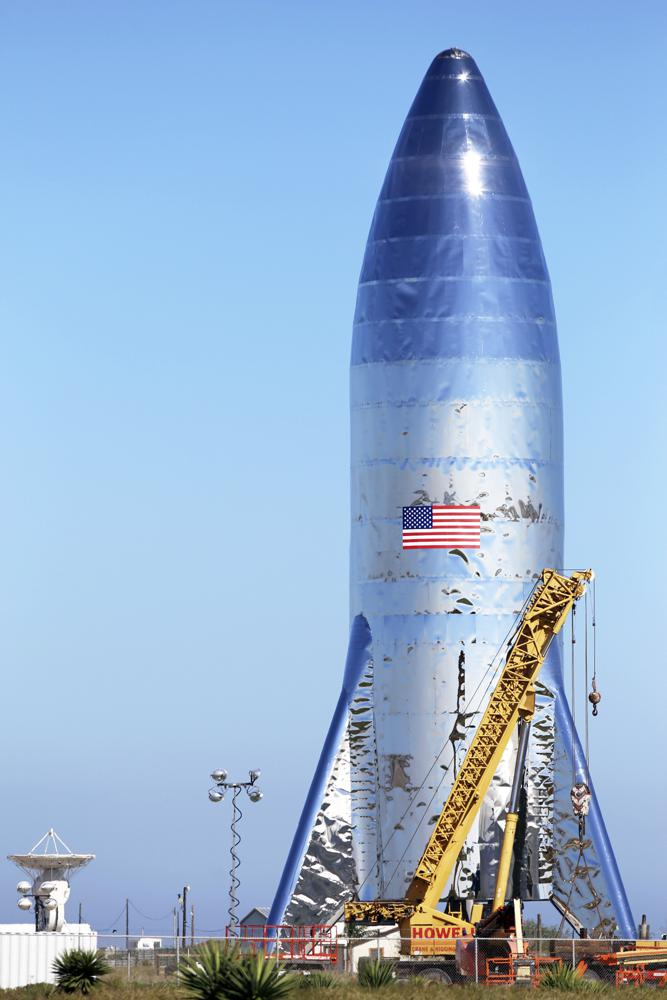 FILE - In this Jan. 12, 2019 file photo, the SpaceX prototype Starship hopper stands at the Boca Chica Beach site in Texas. Jeff Bezos has lost his appeal of NASA's contract with Elon Musk's SpaceX to build its new moon lander. The Government Accountability Office Friday, July 30, 2021 ruled that NASA's award of the $2.9 billion contract to just SpaceX was legal and proper. (Miguel Roberts/The Brownsville Herald via AP, File)