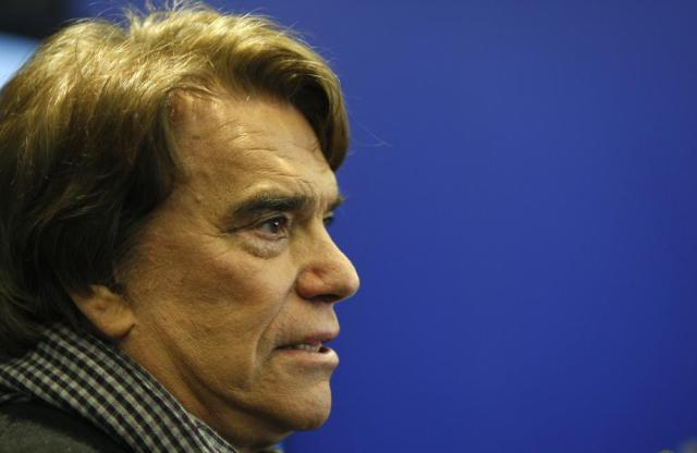 FILE - In this March 12, 2014 file photo, French tycoon Bernard Tapie speaks with the media in Marseille, France. Tapie, the charismatic president of French soccer club Marseille during its glory era whose reign was marred by a match-fixing scandal, died Sunday Oct. 3, 2021. He was 78. (AP Photo/Claude Paris, File)