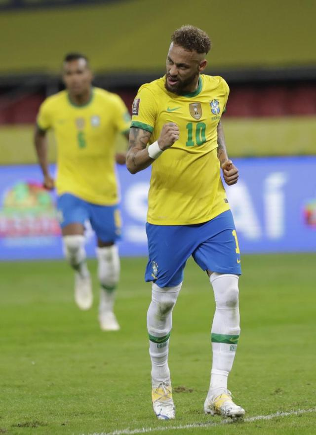 Brazil's Neymar scores his side's second goal on a penalty kick during a qualifying soccer match against Ecuador for the FIFA World Cup Qatar 2022 at Beira-Rio stadium in Porto Alegre, Brazil, Friday, June 4, 2021. Brazil won 2-0. (AP Photo/Andre Penner)