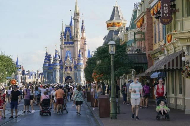 Guests stroll along Main Street at the Magic Kingdom theme park at Walt Disney World Monday, Aug. 30, 2021, in Lake Buena Vista, Fla. The park will celebrate its 50th anniversary on Oct. 1. (AP Photo/John Raoux)