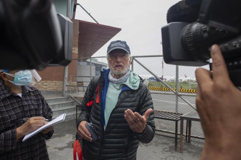 American climber Arthur Muir, 75, gestures to media as he arrives in Kathmandu, Nepal, Sunday, May 30, 2021. The retired attorney from Chicago who became the oldest American to scale Mount Everest, and a Hong Kong teacher who is now the fastest female climber of the world's highest peak, on Sunday returned safely from the mountain where climbing teams have been struggling with bad weather and a coronavirus outbreak. Arthur Muir, 75, scaled the peak earlier this month, beating the record by another American, Bill Burke, at age 67.  (AP Photo/Bikram Rai)