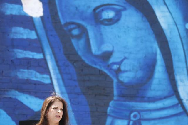 Toledo family attorney Adeena Weiss-Ortiz speaks in front of a mural painted in honor of Adam during a news conference announcing the opening of Adam's Place Inc., a not-for profit organization aiming to help at-risk youth from Chicago and other Midwestern cities to remain out of trouble, Wednesday, May 26, 2021 in Chicago's West Side. Adam Toledo, 13,  was shot and killed March 29 by a Chicago police officer. (AP Photo/Shafkat Anowar)