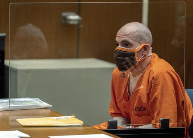 """Michael Thomas Gargiulo listens during a sentencing hearing at Los Angeles Superior Court, Friday, July 16, 2021. Gargiulo has pleaded not guilty to two counts of murder and an attempted-murder charge stemming from attacks in the Los Angeles area between 2001 and 2008, including the death of Kutcher's former girlfriend, 22-year-old Ashley Ellerin.  A judge denied a new trial for Garigiulo, a man prosecutors called """"The Boy Next Door Killer,"""" who could be sentenced to death later Friday for the home-invasion murders of two women and the attempted murder of a third. (AP Photo/Damian Dovarganes)"""