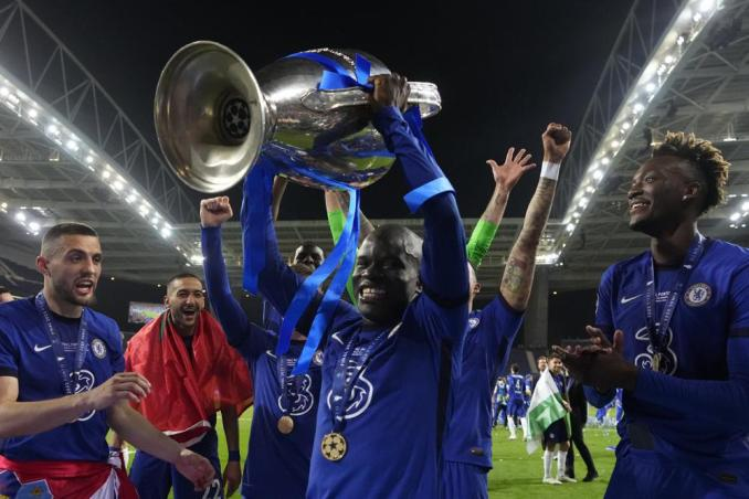 Chelsea's N'Golo Kante celebrates with the trophy after winning the Champions League final soccer match between Manchester City and Chelsea at the Dragao Stadium in Porto, Portugal, Saturday, May 29, 2021. (AP Photo/Manu Fernandez, Pool)