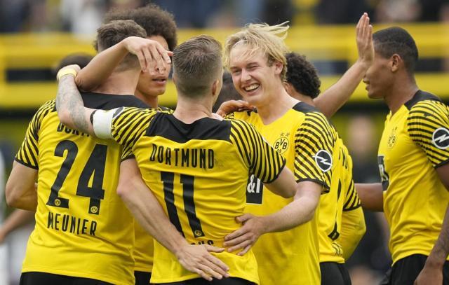 Dortmund's Julian Brandt celebrates after he scored his side's second goal during the German Bundesliga soccer match between Borussia Dortmund and FC Augsburg in Dortmund, Germany, Saturday, Oct. 2, 2021. (AP Photo/Martin Meissner)