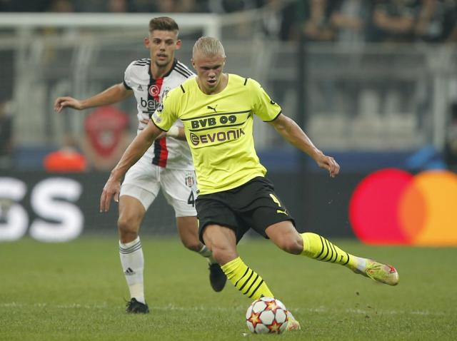 Besiktas' Francisco Montero, left, challenges for the ball with Dortmund's Erling Haaland during the Champions League Group C soccer match between Besiktas and Borussia Dortmund at the Vodafone Park Stadium in Istanbul, Turkey, Wednesday, Sept. 15, 2021. (AP Photo)