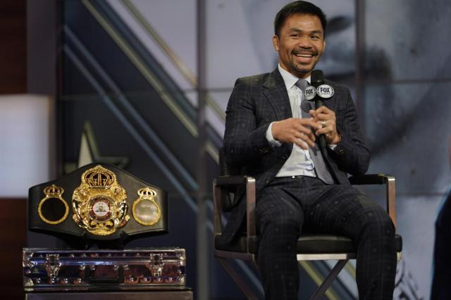 Boxer Manny Pacquiao smiles during a news conference with Errol Spence Jr., Sunday, July 11, 2021, at the Fox Studios lot in Los Angeles ahead of their upcoming boxing match, taking place in Las Vegas on Aug. 21. (AP Photo/Damian Dovarganes)