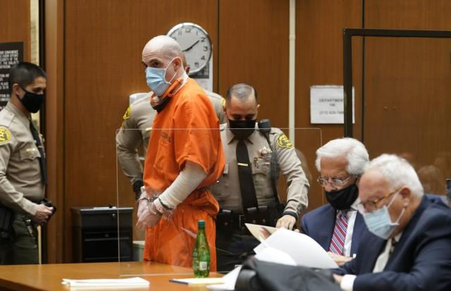 """Michael Thomas Gargiulo, standing, with his defense attorneys, Daniel Nardoni, middle, and Dale Michael Rubin, right, during a sentencing hearing at Los Angeles Superior Court, Friday, July 16, 2021. For crimes he called """"vicious and frightening,"""" Los Angeles Superior Court Judge Larry P. Fidler on Friday gave a death sentence to Gargiulo who prosecutors called """"The Boy Next Door Killer"""" for the home-invasion murders of two women and the attempted murder of a third.  (AP Photo/Damian Dovarganes)"""