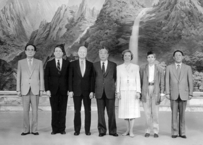 Kim Il Sung, center, poses with Carter, third from left, and his wife Rosalynn Carter, third from right, in 1994. (Korean Central News Agency/Korea News Service via AP)