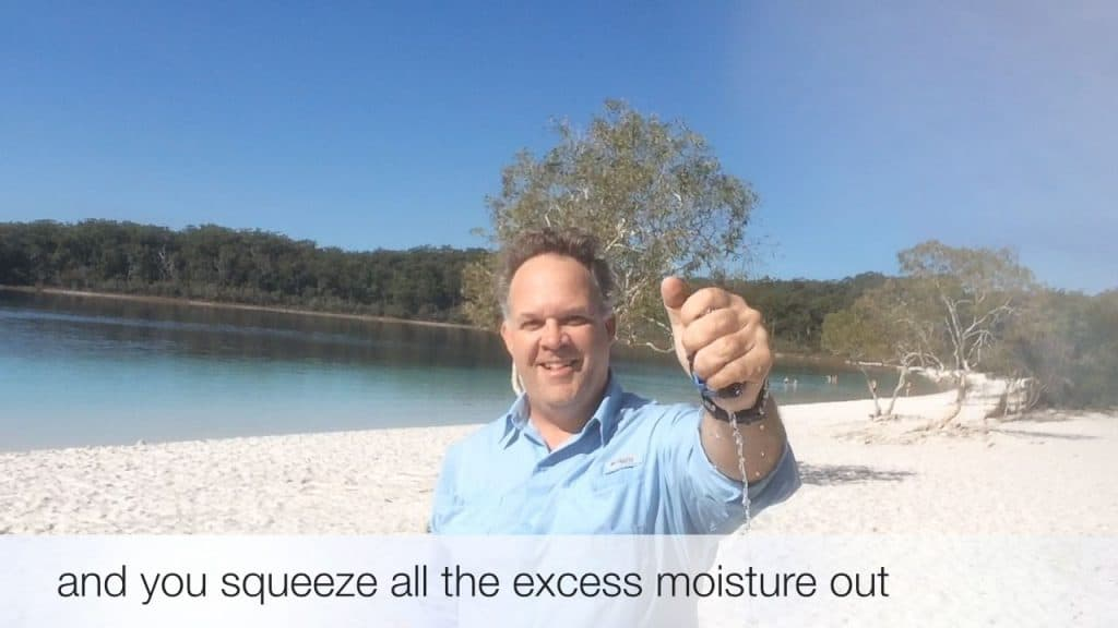 Edward squeezing the water out of the wet Original Buff®. You can clearly see the water flowing out.