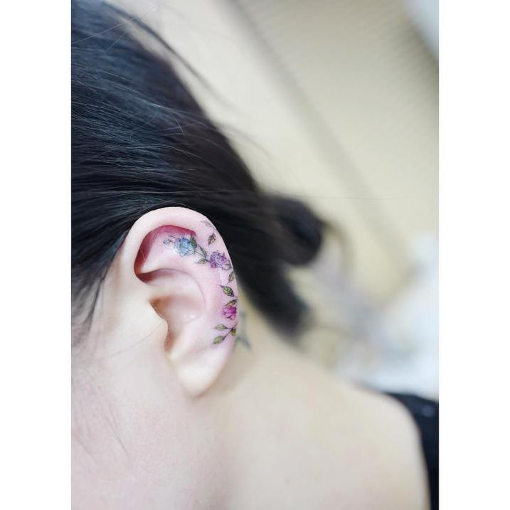 Ear tattoo by Banul