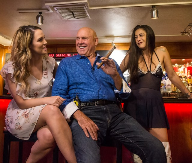 Brothel Owner Dennis Hof Displays One Of His Signature Cigars Flanked By Two Of His Employees Aspen North And Knowme Thursday Afternoon At His Moonlite